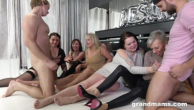 Two young men fuck several oversexed old women